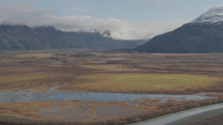 AK0001_0383 - 4K stock footage aerial video approaching marshland and rivers, Chugach Mountains, Portage, Alaska
