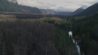 AK0001_0386 - 4K stock footage aerial video flying low over trees and rivers, revealing small homes, Portage, Alaska