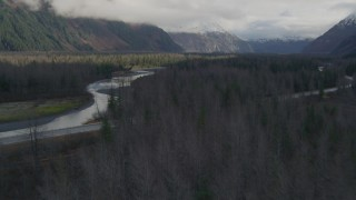AK0001_0387 - 4K stock footage aerial video flying low over trees, revealing a river, Portage, Alaska