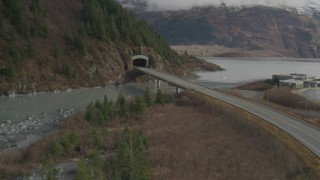 AK0001_0390 - 4K stock footage aerial video follow Portage Glacier Highway approach mountain tunnel, Portage Lake, Alaska