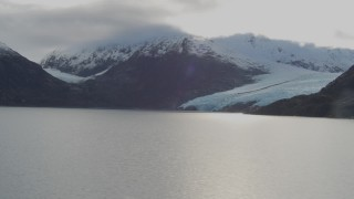 AK0001_0392 - 4K stock footage aerial video flying over lake, pan right to reveal Portage Glacier, Portage Lake, Alaska