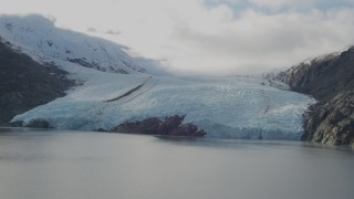 AK0001_0393 - 4K stock footage aerial video flying by glacier, on the shore of Portage Lake, Portage Glacier, Alaska