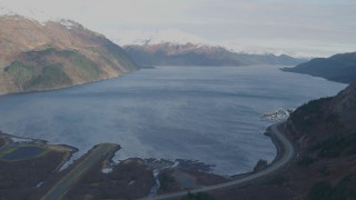 AK0001_0395 - 4K stock footage aerial video fly over Whittier Airport, approach bay, reveal West Camp Road, Whittier, Alaska