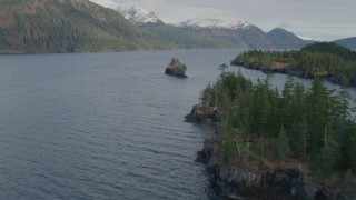 AK0001_0402 - 4K stock footage aerial video flying by Forested shoreline, small island, open waters, Passage Canal, Alaska
