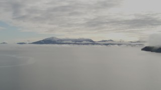 AK0001_0411 - 4K stock footage aerial video flying low over the bay covered in low clouds, Prince William Sound, Alaska