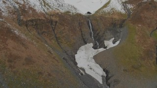 AK0001_0417 - 4K stock footage aerial video approach small waterfall, Chugach Mountain peak, Prince William Sound, Alaska
