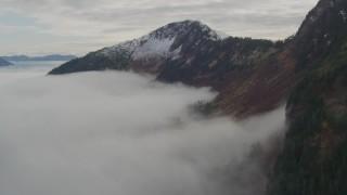 AK0001_0418 - 4K stock footage aerial video flying over fog, approach Chugach Mountain ridge, Prince William Sound, Alaska