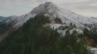 AK0001_0419 - 4K stock footage aerial video ascend tree lined slope of Chugach Mountain ridge, Prince William Sound, Alaska