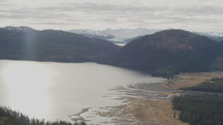AK0001_0424 - 4K stock footage aerial video flying by river emptying into bay, Prince William Sound, Alaska