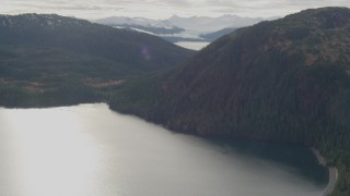 AK0001_0425 - 4K stock footage aerial video fly over river valley, approaching forested ridge, Prince William Sound, Alaska