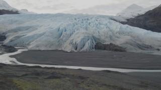AK0001_0436 - 4K stock footage aerial video tilt from shallow creek to reveal glacier, Prince William Sound, Alaska
