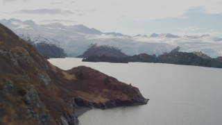 AK0001_0468 - 4K stock footage aerial video tilt up revealing shoreline, reveal glacier and island, Blackstone Bay, Alaska