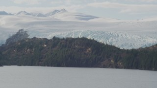 AK0001_0469 - 4K stock footage aerial video flying by an island in the bay, glacier behind it, Blackstone Bay, Alaska