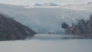 AK0001_0471 - 4K stock footage aerial video flying by glacier spilling into Blackstone Bay, Alaska