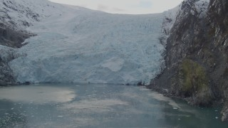 AK0001_0473 - 4K stock footage aerial video approaching glacier spilling into the bay, zoom in, Blackstone Bay, Alaska