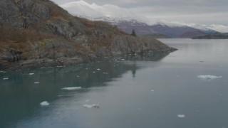 AK0001_0476 - 4K stock footage aerial video fly along rocky, tree lined shore, Chugach Mountains, Blackstone Bay, Alaska