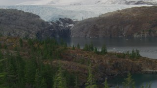 AK0001_0477 - 4K stock footage aerial video flying over edge of island, pan to reveal glacier, Blackstone Bay, Alaska
