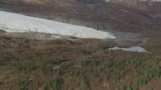 AK0001_0481 - 4K stock footage aerial video fly by part of glacier on rocky land, near small pond, Blackstone Bay, Alaska
