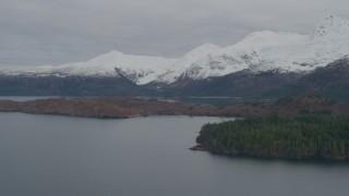 AK0001_0483 - 4K stock footage aerial video flying by island, snow capped Chugach Mountains, Blackstone Bay, Alaska