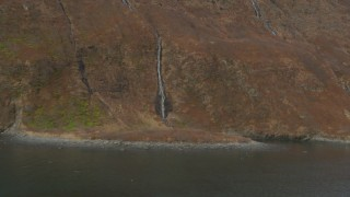 AK0001_0486 - 4K stock footage aerial video small waterfalls pouring down face of Chugach Mountain, Blackstone Bay, Alaska