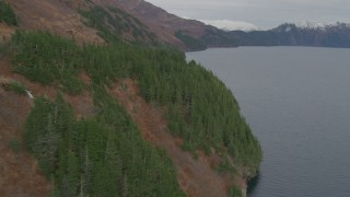 AK0001_0488 - 4K stock footage aerial video flying along steep slope of mountain peak on the shore, Blackstone Bay, Alaska