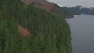 AK0001_0490 - 4K stock footage aerial video flying along steep slope of a mountain peak on coast, Blackstone Bay, Alaska