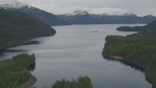 AK0001_0494 - 4K stock footage aerial video flying over shore, approaching barge, Passage Canal, Shotgun Cove, Alaska