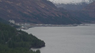 AK0001_0497 - 4K stock footage aerial video approaching the town of Whittier in the Prince William Sound, Whittier, Alaska