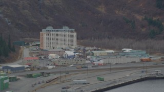 AK0001_0500 - 4K stock footage aerial video flying by an apartment building, train tracks, Whittier, Alaska