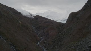 AK0001_0503 - 4K stock footage aerial video flying through a shallow canyon, revealing Portage Glacier, Alaska
