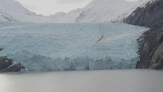 AK0001_0505 - 4K stock footage aerial video flying by the edge of glacier on Portage Lake, Portage Glacier, Alaska