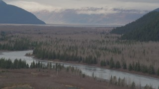 AK0001_0509 - 4K stock footage aerial video flying by the river valley, tilt down to the river, Portage, Alaska