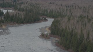 AK0001_0510 - 4K stock footage aerial video approaching a river cutting through forest, Portage, Alaska
