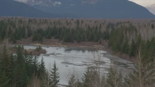 AK0001_0511 - 4K stock footage aerial video lying over a tree line, revealing a river in the valley, Portage, Alaska