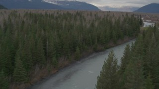AK0001_0512 - 4K stock footage aerial video flying low over a river cutting through the forest, Portage, Alaska