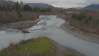 AK0001_0513 - 4K stock footage aerial video flying along rivers cutting through forest in the valley, Portage, Alaska