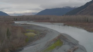 AK0001_0516 - 4K stock footage aerial video following river cutting through dead trees in the valley, Portage, Alaska