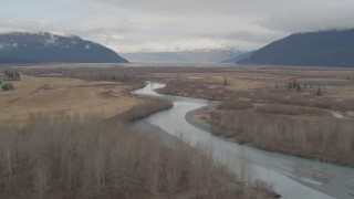 AK0001_0518 - 4K stock footage aerial video flying low over river, ascending the tree line to reveal river valley, Portage, Alaska