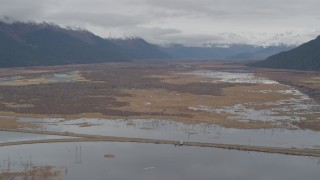 AK0001_0519 - 4K stock footage aerial video flying by marshland valley beyond train tracks, Portage, Alaska
