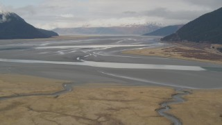 AK0001_0520 - 4K stock footage aerial video flying by valley on the edge of Turnagain Arm of the Cook Inlet, Portage, Alaska
