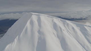 AK0001_0529 - 4K stock footage aerial video orbiting snowy mountain peak, Kenai Mountains, Alaska