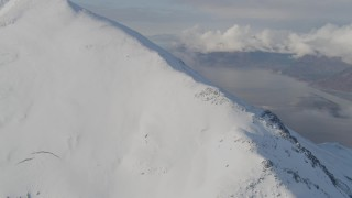 AK0001_0544 - 4K stock footage aerial video approaching and ascending snowy ridge towards summit, Kenai Mountains, Alaska