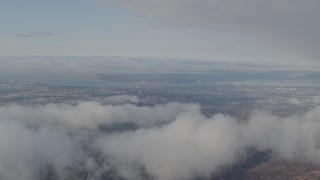 AK0001_0567 - 4K stock footage aerial video flying by low clouds over Anchorage, from Chugach Mountains, Anchorage, Alaska