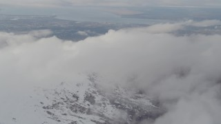 AK0001_0572 - 4K stock footage aerial video approach snowy peak, Downtown Anchorage, Chugach Mountains, Alaska