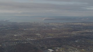 AK0001_0579 - 4K stock footage aerial video descending through low clouds, revealing Downtown Anchorage, Alaska