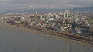 AK0001_0590 - 4K stock footage aerial video flying over the shore, approaching Downtown Anchorage, Alaska