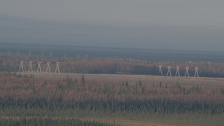 AK0001_0594 - 4K stock footage aerial video flying by power lines, forests, Point MacKenzie, Alaska