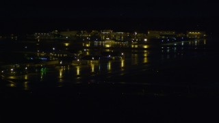 AK0001_0600 - 4K stock footage aerial video flying by Merrill Field, Anchorage, Alaska, night