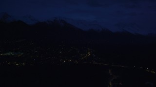 AK0001_0605 - 4K stock footage aerial video fly by neighborhood lights, base of Chugach Mountains, Anchorage, Alaska, night