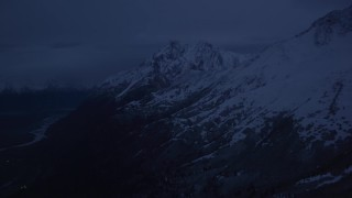 AK0001_0613 - 4K stock footage aerial video flying by snowy Chugach Mountains, reveal river valley, Palmer, Alaska, sunrise
